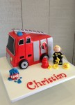 Fire Truck with Fireman figurine 7 inch Cake